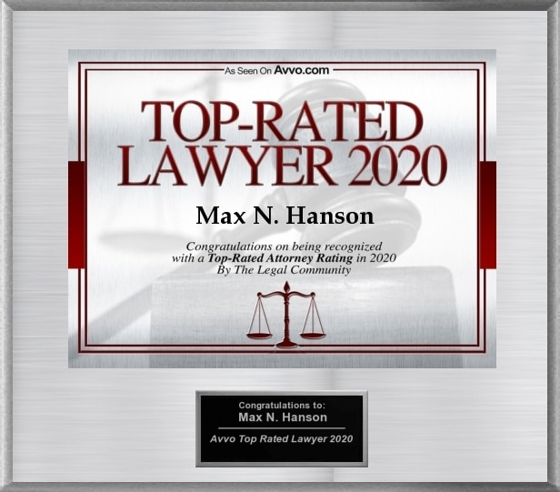 "Silver electronic plaque with red lettering that reads ""Top-Rated Lawyer 2020 Max N. Hanson"""