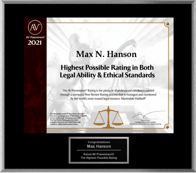 "Black and cream plaque with lettering that reads ""Max N. Hanson - Highest Possible Rating in Both Legal Ability and Ethical Standards"""