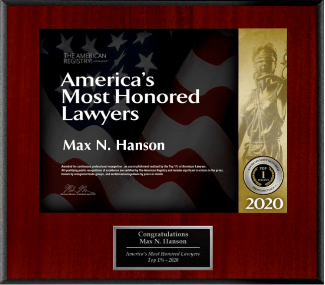 "Red and black plaque that reads ""America's Most Honored Lawyers Max N. Hanson"""