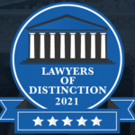 "Royal blue badge with 5 white starts and text that reads ""Lawyers of Distinction 2021"""