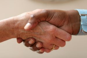 close up of two hands engaging in a handshake