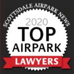 Black and white round logo with text that reads 'Scottsdale Airpark news 2020 Top Airpark Lawyers'