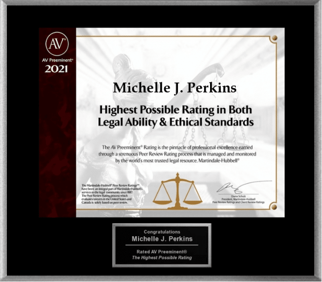 "Black and cream electronic plaque with lettering that reads ""Michelle J. Perkins Highest Possible Rating in Both legal ability and ethical standards"""