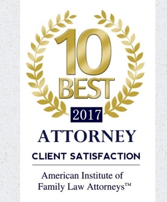 White plaque with blue and gold writing that reads '10 best 2017 Attorney - client satisfaction'